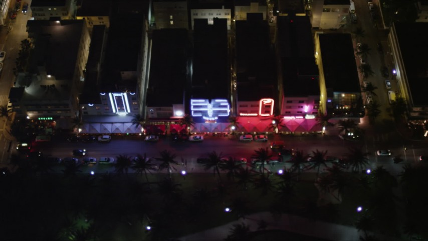5K stock footage aerial video of Ocean Drive hotels at night in South Beach, Florida Aerial Stock Footage | AX0023_123