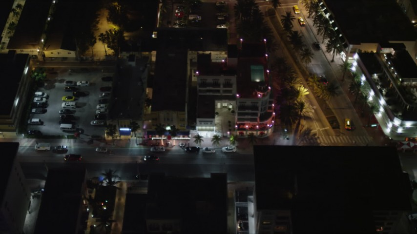 5K stock footage aerial video of passing South Beach hotels on Ocean Drive at night, Florida Aerial Stock Footage | AX0023_125