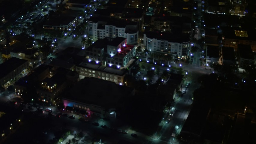 Approach South Beach Office Building at Night  Aerial Stock Footage | AX0023_126