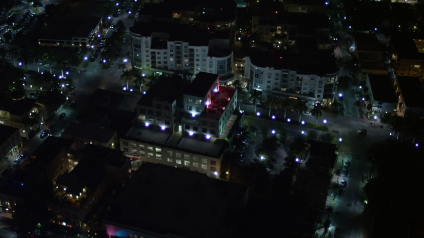 5K stock footage aerial video of approach South Beach office building at night, Florida Aerial Stock Footage | AX0023_126