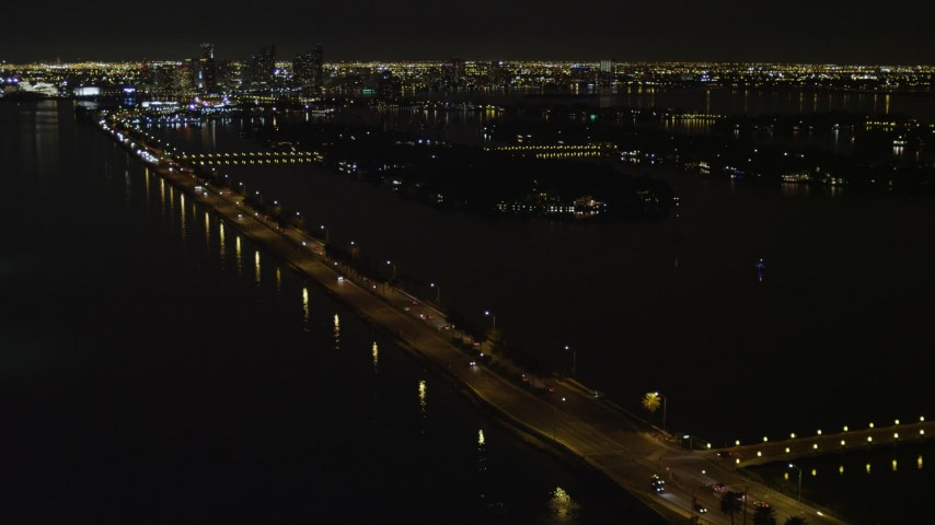 5K stock footage aerial video of approaching the MacArthur Causeway with light traffic at night in Miami, Florida Aerial Stock Footage | AX0023_127