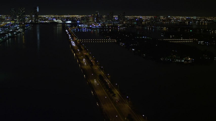 5K stock footage aerial video of approaching the MacArthur Causeway with light traffic at night in Miami, Florida Aerial Stock Footage | AX0023_127E