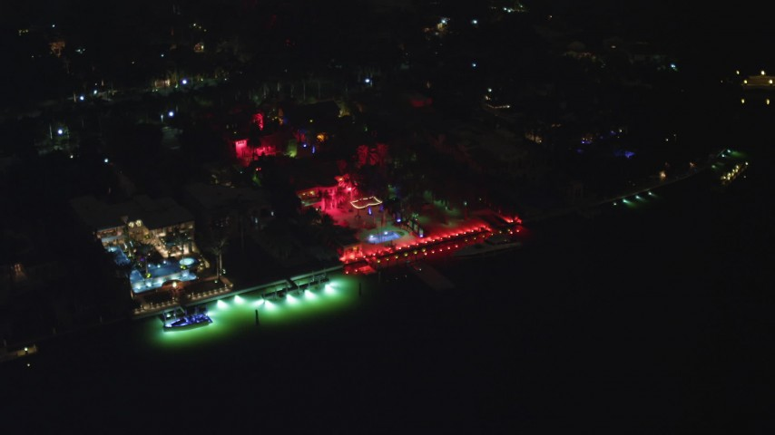 5K stock footage aerial video of 5 Star Island Hotel with red lights at nighttime, Florida Aerial Stock Footage | AX0023_129