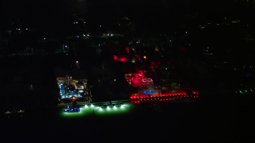 5K stock footage aerial video of 5 Star Island Hotel with red lights at nighttime, Florida Aerial Stock Footage | AX0023_129E