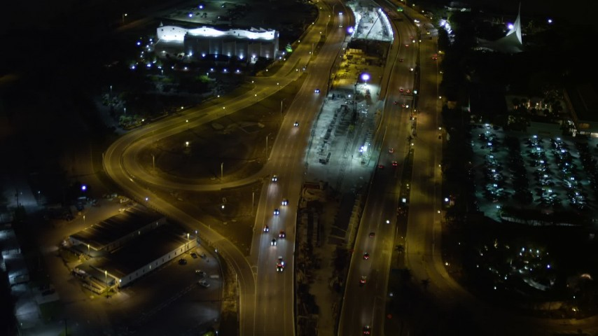 5K aerial video fly over traffic on the MacArthur Causeway through Watson Island at night, Florida Aerial Stock Footage | AX0023_136