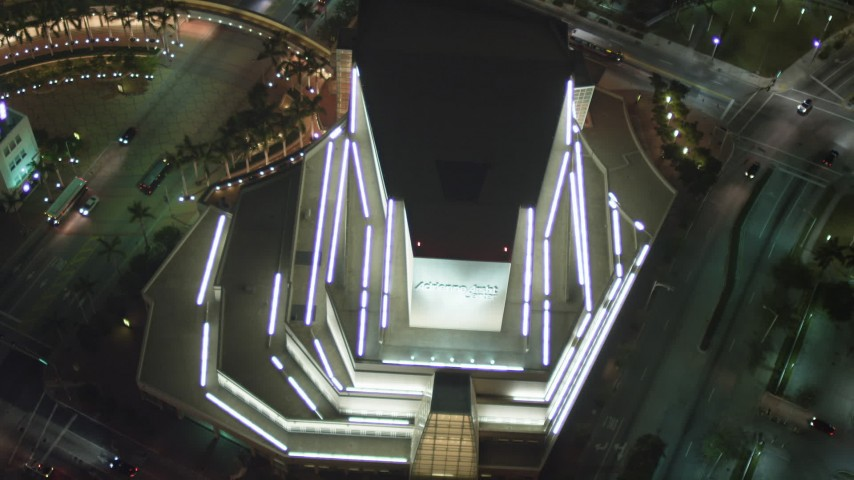 5K stock footage aerial video tilt to bird's eye view of Adrienne Arsht Center for the Performing Arts at night in Downtown Miami, Florida Aerial Stock Footage | AX0023_141