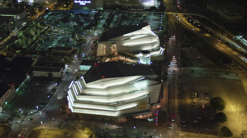 5K stock footage aerial video of reverse view of the Adrienne Arsht Center for the Performing Arts at night in Downtown Miami, Florida Aerial Stock Footage | AX0023_143