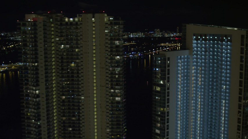 5K stock footage aerial video flyby 900 Biscayne Bay and MarinaBlue at night in Downtown Miami, Florida Aerial Stock Footage | AX0023_144
