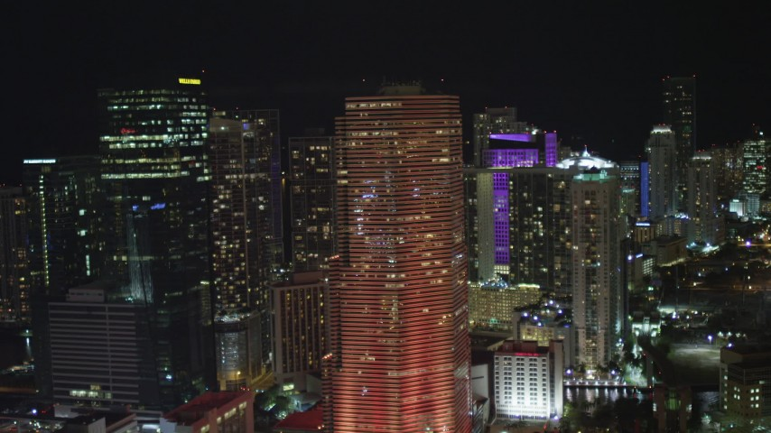 5K stock footage aerial video of passing Miami Tower with orange lighting at night in Downtown Miami, Florida Aerial Stock Footage | AX0023_145