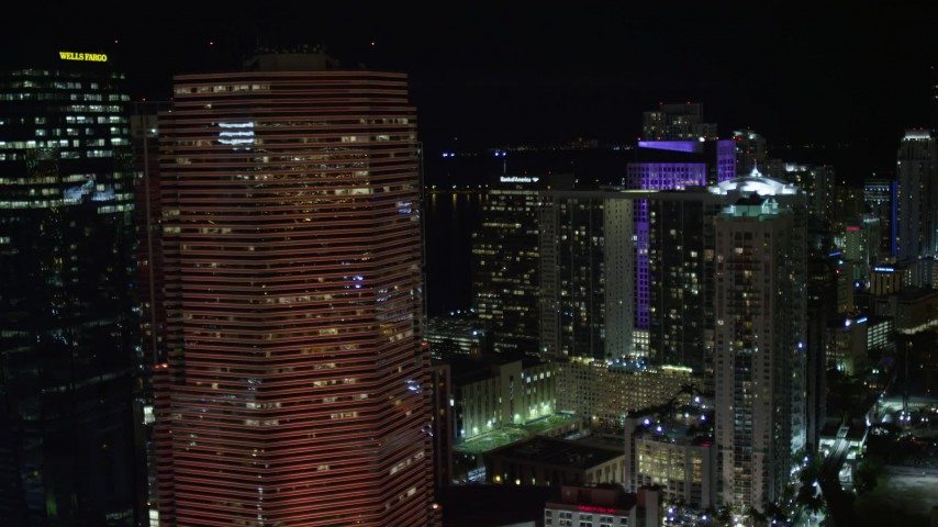 5K stock footage aerial video of passing Miami Tower with orange lighting at night in Downtown Miami, Florida Aerial Stock Footage | AX0023_145E