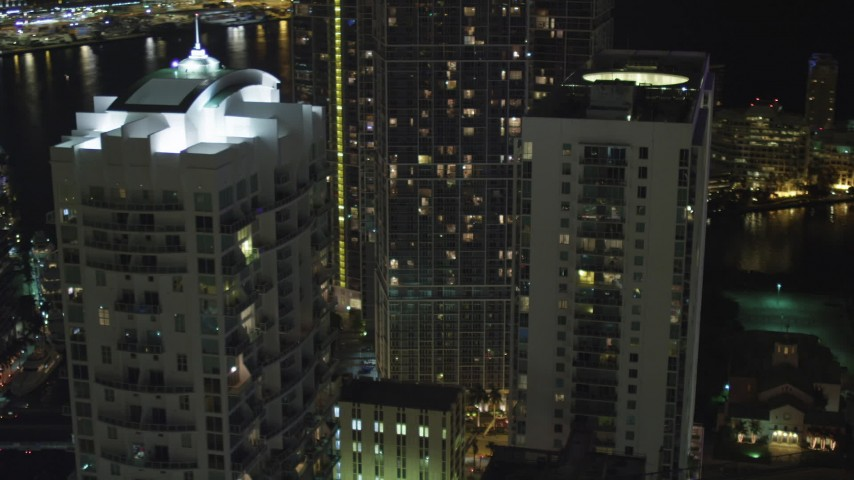 5K stock footage aerial video flyby Brickell on the River and 500 Brickell at night in Downtown Miami, Florida Aerial Stock Footage | AX0023_147