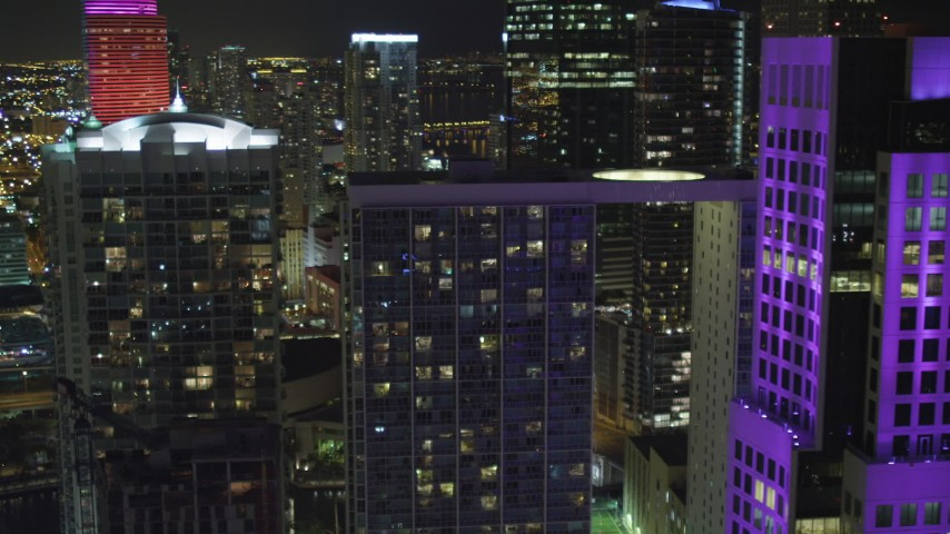 5K stock footage aerial video flyby 500 Brickell to reveal Brickell World Plaza at night in Downtown Miami, Florida Aerial Stock Footage | AX0023_148