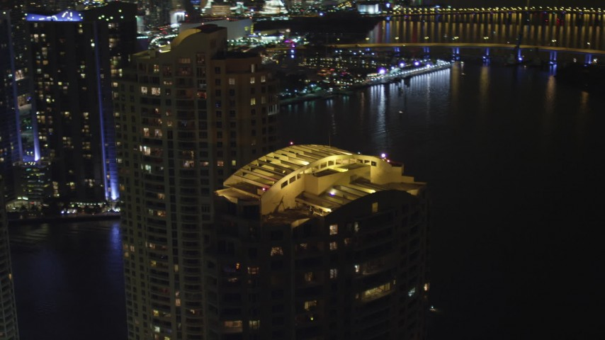5K stock footage aerial video of rooftops of Brickell Key skyscrapers at night in Downtown Miami, Florida Aerial Stock Footage | AX0023_150