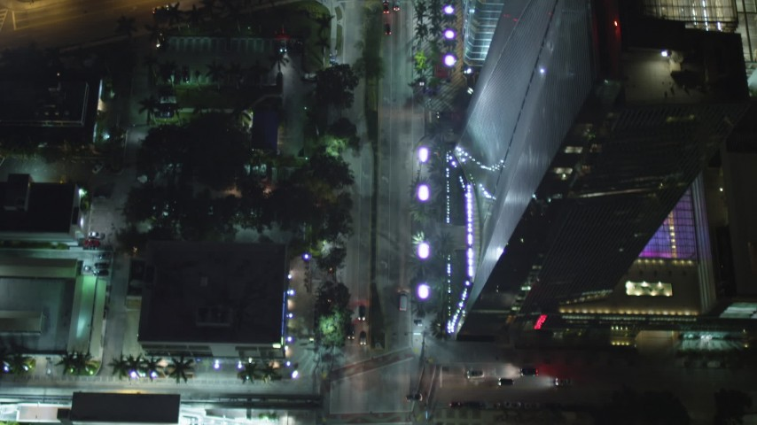 5K stock footage aerial video bird's eye of Brickell Avenue at night and reveal hotel in Downtown Miami, Florida Aerial Stock Footage | AX0023_162