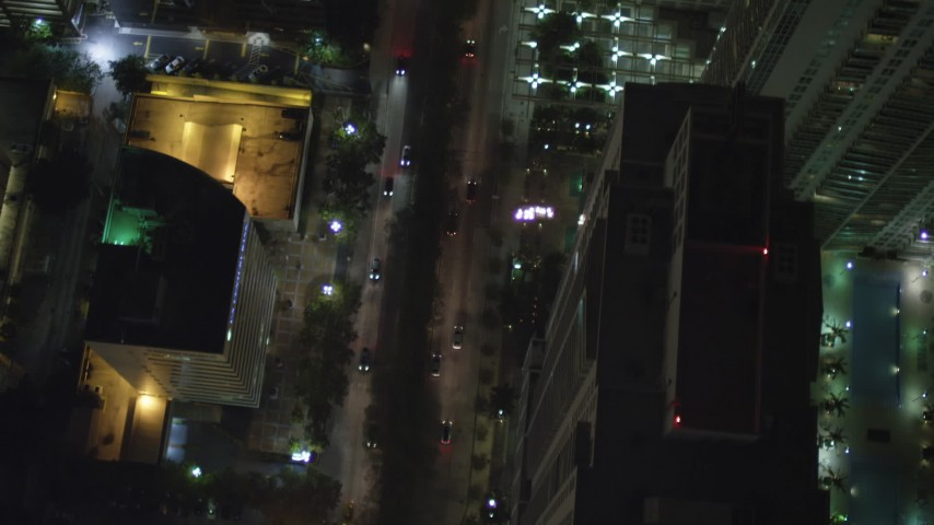 5K stock footage aerial video of bird's eye view of Brickell Avenue through Downtown Miami at night, Florida Aerial Stock Footage | AX0023_164