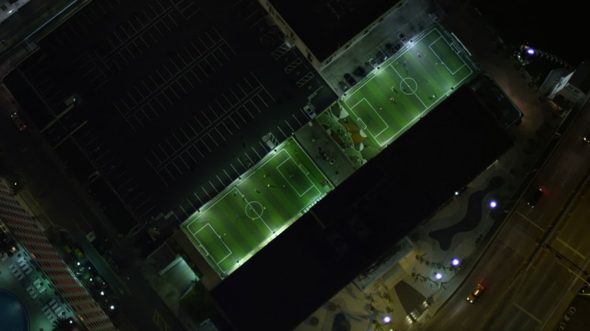 5K stock footage aerial video bird's eye view of soccer fields at night in Downtown Miami, Florida Aerial Stock Footage | AX0023_169