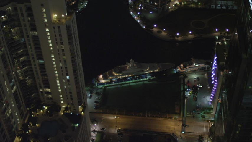 5K stock footage aerial video flyby yacht on the river and Downtown Miami skyscrapers at night, Florida Aerial Stock Footage | AX0023_170