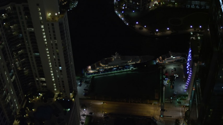 5K stock footage aerial video flyby yacht on the river and Downtown Miami skyscrapers at night, Florida Aerial Stock Footage | AX0023_170E