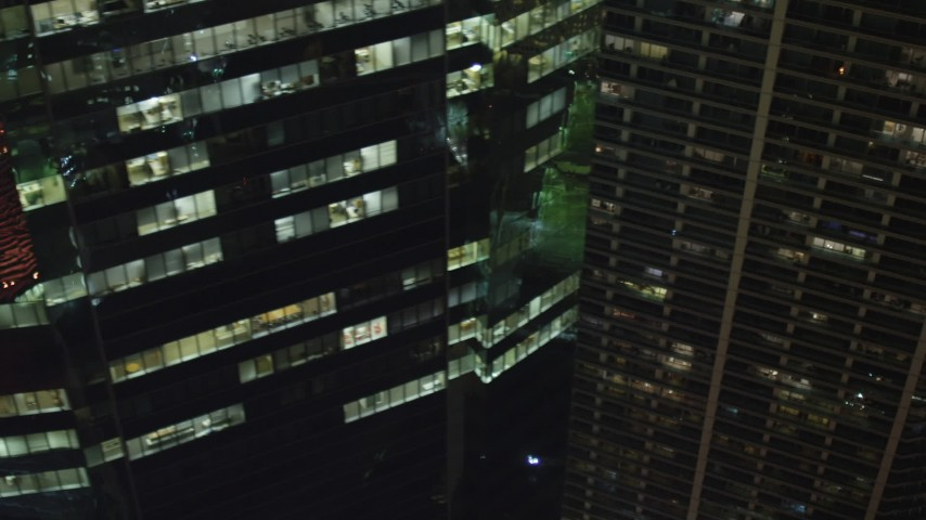 5K stock footage aerial video flyby Southeast Financial Center at night to reveal hotel in Downtown Miami, Florida Aerial Stock Footage | AX0023_174