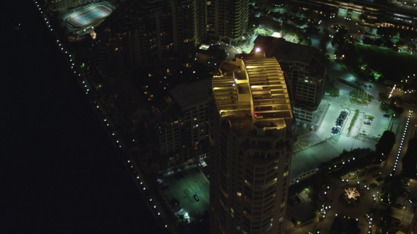 5K stock footage aerial video orbit skyscraper's rooftop on Brickell Key at night in Downtown Miami, Florida Aerial Stock Footage | AX0023_176