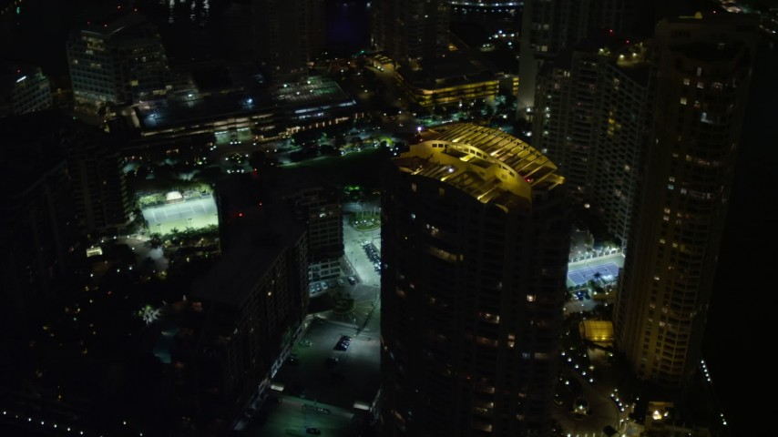 5K stock footage aerial video orbit skyscraper's rooftop on Brickell Key at night in Downtown Miami, Florida Aerial Stock Footage   AX0023_176E