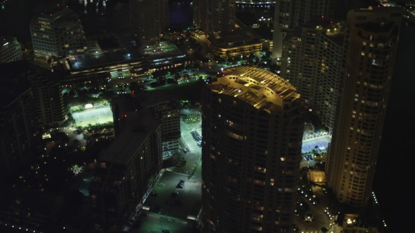 5K stock footage aerial video of a skyscraper on Brickell Key at night in Downtown Miami, Florida Aerial Stock Footage | AX0023_177