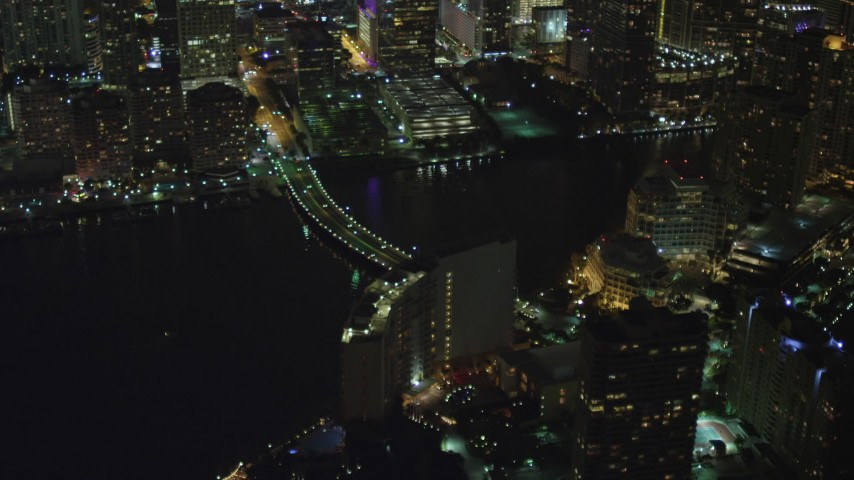 5K stock footage aerial video of Brickell Key Drive Bridge at night in Downtown Miami, Florida Aerial Stock Footage | AX0023_178