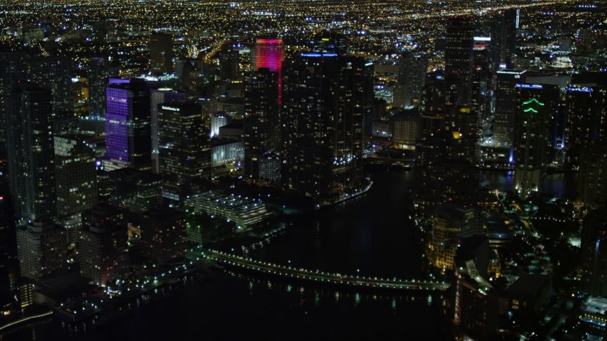 5K stock footage aerial video of Brickell Key Drive Bridge and skyscrapers at night in Downtown Miami, Florida Aerial Stock Footage | AX0023_178E