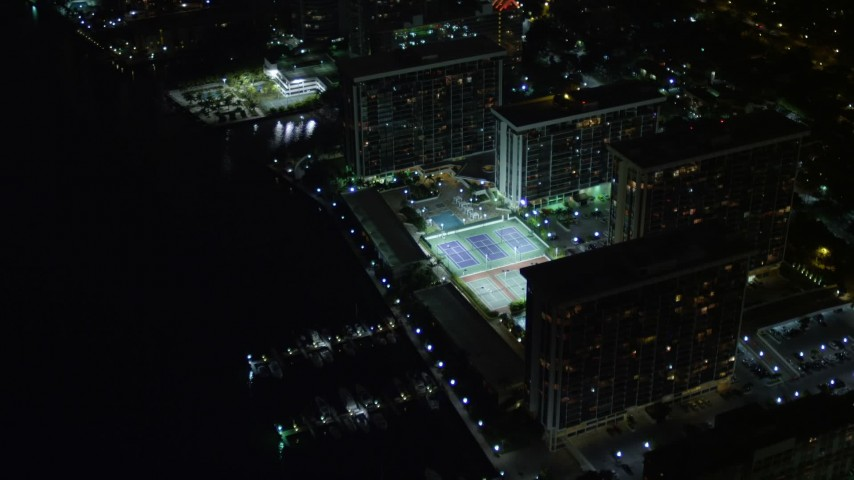 5K stock footage aerial video approach waterfront apartment buildings at night in Downtown Miami, Florida Aerial Stock Footage   AX0023_181E