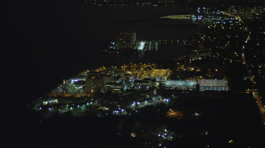 5K stock footage aerial video approach Mercy Hospital at night in Coconut Grove, Florida Aerial Stock Footage | AX0023_183