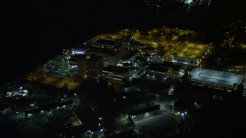 5K stock footage aerial video approach Mercy Hospital at night in Coconut Grove, Florida Aerial Stock Footage   AX0023_183E