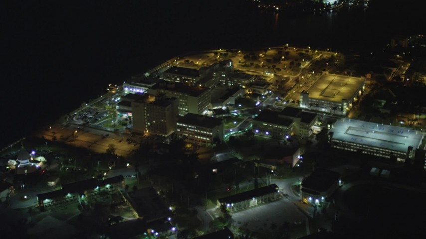 5K stock footage aerial video approach Mercy Hospital at night in Coconut Grove, Florida Aerial Stock Footage | AX0023_184