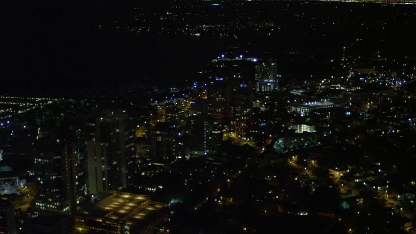 5K stock footage aerial video of passing office buildings at night in Coconut Grove, Florida Aerial Stock Footage | AX0023_186