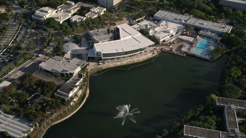 5K stock footage aerial video of Maurice Gusman Concert Hall and Lake Osceola, University of Miami, Coral Gables, Florida Aerial Stock Footage | AX0024_011