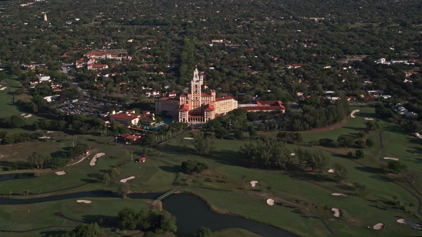 5K stock footage aerial video of approaching the Coral Gables Biltmore Hotel, Coral Gables, Florida Aerial Stock Footage | AX0024_013