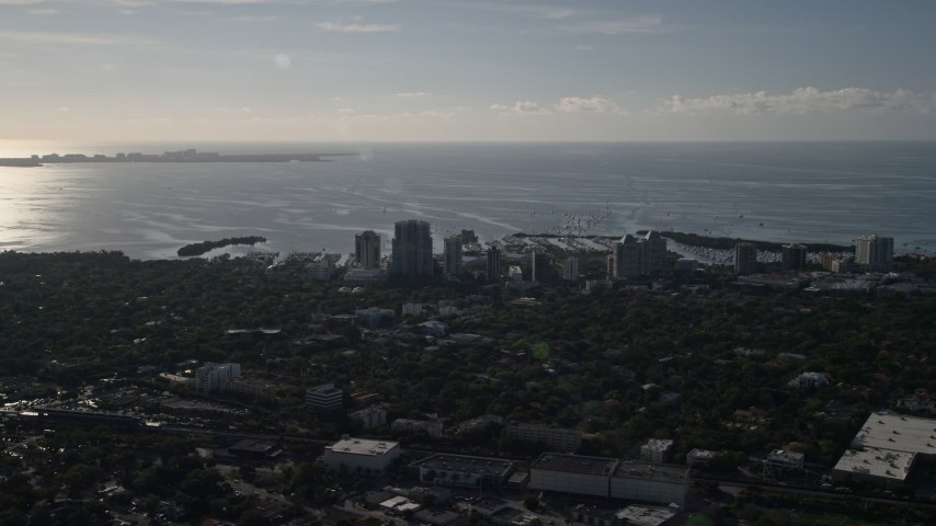 5K stock footage aerial video of flying by coastal hotels, apartment buildings in Coconut Grove, Florida Aerial Stock Footage | AX0024_024