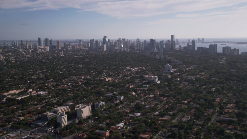 5K stock footage aerial video fly over neighborhoods, reveal Downtown Miami skyline, Coconut Grove, Florida Aerial Stock Footage | AX0024_025