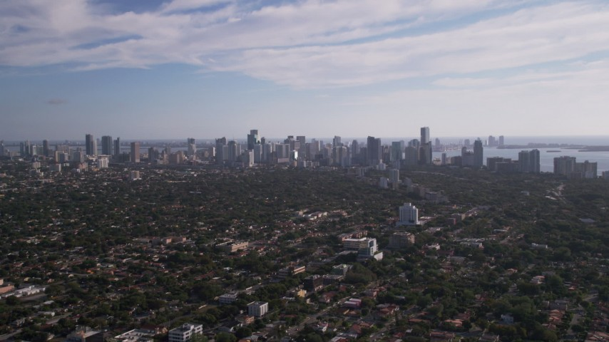 5K stock footage aerial video of approaching Downtown Miami skyline from Coconut Grove, Florida Aerial Stock Footage | AX0024_026