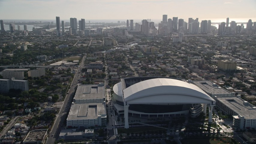 5K stock footage aerial video tilt from Marlins Park revealing Downtown Miami skyline, Florida Aerial Stock Footage | AX0024_033
