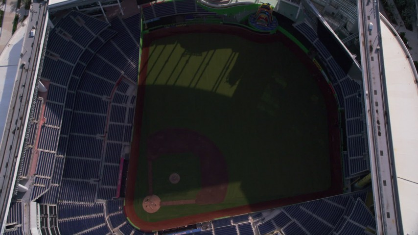 5K stock footage aerial video of approaching Marlins Park for a bird's eye view of inside the stadium, Miami, Florida Aerial Stock Footage | AX0024_035