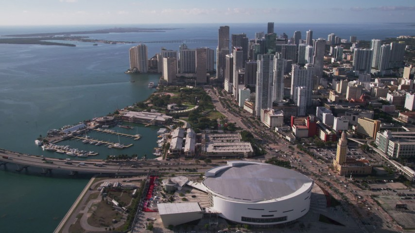 5K stock footage aerial video of American Airlines Arena, Bayfront Park, and skyscrapers in Downtown Miami, Florida Aerial Stock Footage | AX0024_039