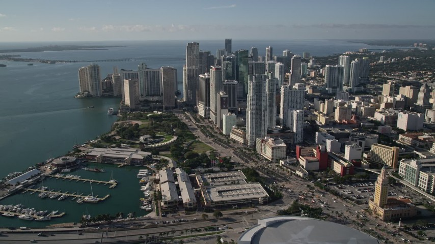 5K stock footage aerial video of American Airlines Arena, Bayfront Park, and skyscrapers in Downtown Miami, Florida Aerial Stock Footage | AX0024_039E