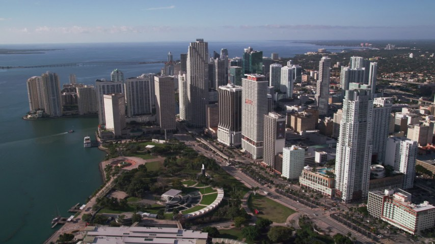 5K stock footage aerial video of flying over Bayfront Park beside skyscrapers, Downtown Miami, Florida Aerial Stock Footage | AX0024_040
