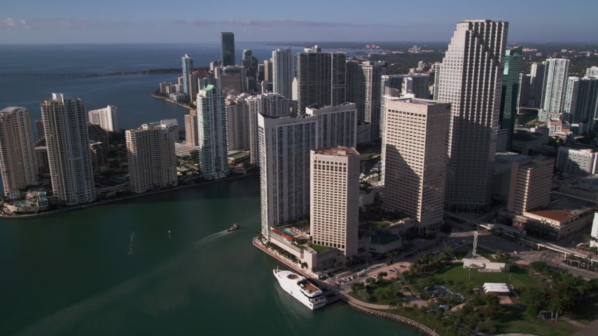 5K stock footage aerial video of flying by coastal skyscrapers toward Miami River, Downtown Miami, Florida Aerial Stock Footage | AX0024_041