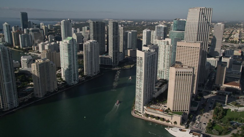 5K stock footage aerial video of flying by coastal skyscrapers and reveal Miami River, Downtown Miami, Florida Aerial Stock Footage | AX0024_041E