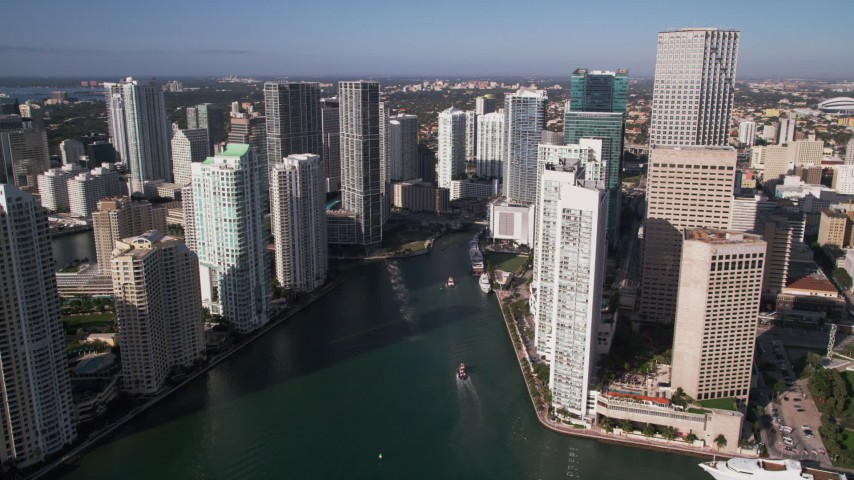 5K aerial stock footage video of flying by skyscrapers, revealing Miami River, Downtown Miami, Florida Aerial Stock Footage | AX0024_042