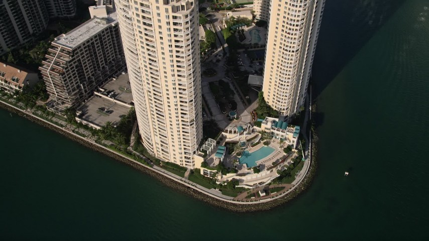 5K stock footage aerial video of pool area between condominium complexes on Brickell Key, Downtown Miami, Florida Aerial Stock Footage | AX0024_043