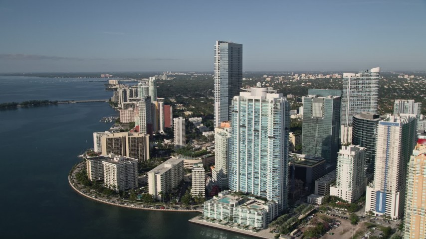 5K stock footage aerial video fly over Mandarin Oriental on Brickell Key toward skyscrapers and apartment buildings in Downtown Miami, Florida Aerial Stock Footage | AX0024_044E