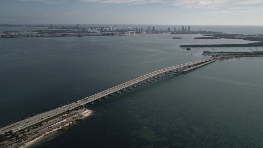 5K stock footage aerial video of flying away from the Rickenbacker Causeway on Biscayne Bay, Florida Aerial Stock Footage | AX0024_049
