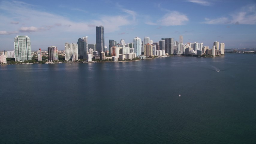 5K aerial video tilt from Biscayne Bay to reveal Rickenbacker Causeway, Downtown Miami, Florida Aerial Stock Footage AX0024_052